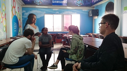 UCLAN students having a chat with a student in the Safaricom Academy